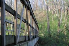 Wooden bridge in an ohio trial. Wooden, bridge, trail, cross, motivational, Ohio, seasons, fall, summer, spring, exploration, outdoor, Canon, blue, sky, green Stock Photo