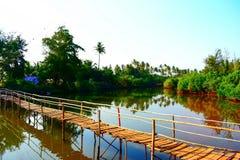 Wooden bridge over backwaters stock photos