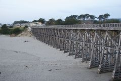 Wooden Bridge over Beach Stock Images