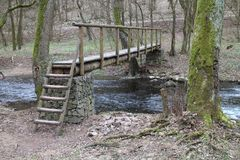 Wooden bridge over brook near Castle of Countess Elisabeth Báthory, Čachtice. Slovakia stock photography