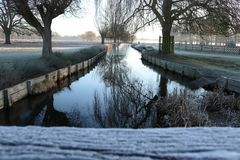 Wooden bridge over the canal stock image