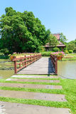 A wooden bridge over a canal in the park Stock Image