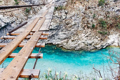 Wooden bridge over canyon Royalty Free Stock Photos