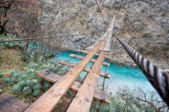 Wooden bridge over canyon Stock Image