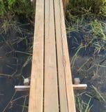 Wooden bridge over the Creek Stock Photos