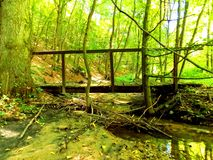 Wooden bridge over creek Royalty Free Stock Photos