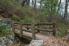 Wooden bridge over dry creek in the area Lake Park Waterfall, Milwaukee, Wisconsin, USA. Autumn landscape with a wooden bridge, and dry creek, Lake Park Royalty Free Stock Photography
