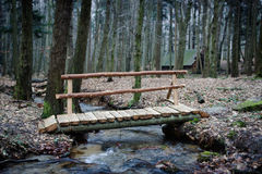 Wooden Bridge Over Forest Brook Royalty Free Stock Photos