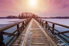 Wooden bridge over frozen river Stock Photography