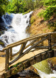 Wooden bridge over the gorge and the Datanla waterfall in Da Lat Stock Images