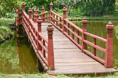Wooden bridge over a lake Royalty Free Stock Photo