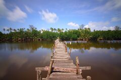 Wooden bridge over lake Stock Photo