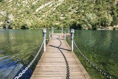Wooden bridge over a lake Stock Photo