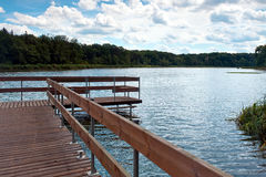 Wooden bridge over lake Royalty Free Stock Photography