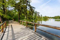 Wooden bridge over lake. In city park Stock Photography