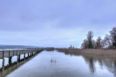 Wooden bridge over lake Royalty Free Stock Photo