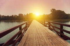 Wooden bridge over lake Stock Photos