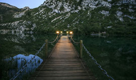 Wooden bridge over a lake in the night Stock Photo