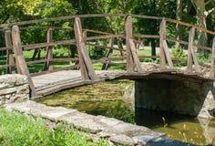 The wooden bridge over the lake Royalty Free Stock Photos