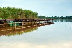 Wooden bridge over lake Stock Photography