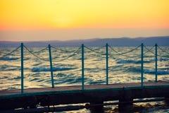 Wooden bridge over lake at sunset Royalty Free Stock Photo