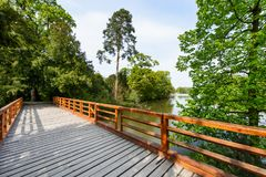 Wooden bridge over lake. In city park Stock Images