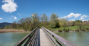 Wooden bridge over mangfall river, spa town gmund at lake tegern Stock Photography