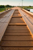 Wooden bridge over marsh in Pantanal wetland region, Brazil. Low level, wide-angle shot Royalty Free Stock Photos