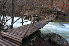 Wooden bridge over mountain river Royalty Free Stock Image