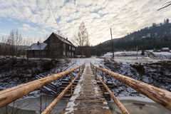 Wooden bridge over mountain river in Ukraine. Carpathians Royalty Free Stock Images
