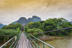 Wooden bridge over Nam Song river Royalty Free Stock Photography