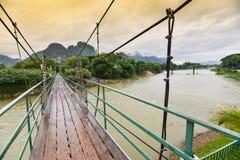 Wooden bridge over Nam Song river Stock Photo