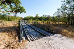 Wooden bridge over Okavango swamps. Kwai region, Okavango Delta, Botswana Royalty Free Stock Image