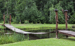 Wooden bridge over pond Stock Photography