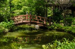 Bridge over a pond. Wooden bridge over a pond in a Japanese garden Royalty Free Stock Image