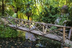 Wooden bridge over a pond in one of the parks stock photography