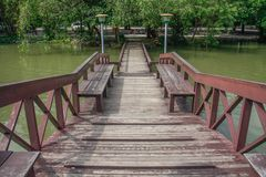 Wooden bridge over pond Royalty Free Stock Photo