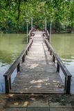 Wooden bridge over pond Royalty Free Stock Images