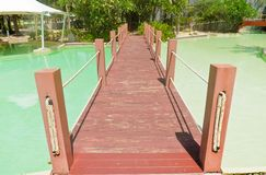 Wooden bridge over the pool Royalty Free Stock Photo
