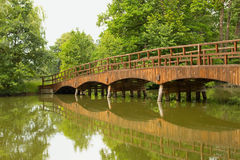 Wooden bridge over a quiet river Royalty Free Stock Photo