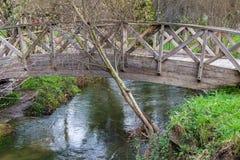 Wooden bridge over the river Stock Photos