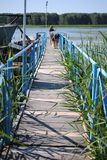 Wooden bridge over the river Stock Image