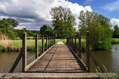 Wooden bridge over the river Stock Photos