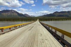 Wooden bridge over river Stock Images