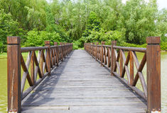 Wooden bridge. With balustrade. Wood bridge over the river in the forest Stock Photos