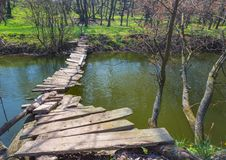 Wooden bridge over the river Royalty Free Stock Photo