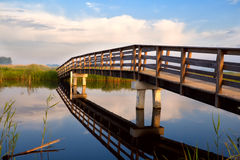 Wooden bridge over river Royalty Free Stock Photos