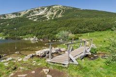 Wooden bridge over river in Pirin Mountain near Bezbog lake Stock Images