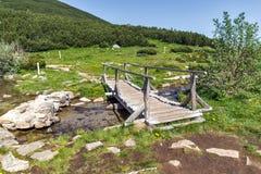 Wooden bridge over river in Pirin Mountain near Bezbog lake Royalty Free Stock Photography