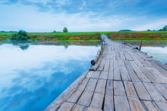 Wooden bridge over a small lake Stock Images